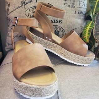 Tan shoe with wedge. Perfect for any event!